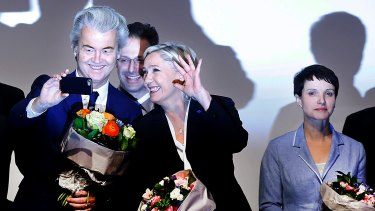 Dutch Freedom Party leader Geert Wilders, left, and French presidential candidate Marine Le Pen enjoy a selfie with Marcus Pretzell while his wife, Alternative for Germany leader Frauke Petry, stands to one side after a summit of European far-right leaders in Koblenz.