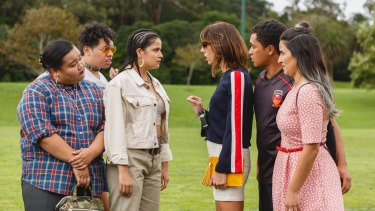 The Breaker Upperers, right, Jackie van Beek in striped top as Jen and Madeleine Sami in pink dress (Mel) with James Rolleston (James) as they confront his girlfriend Sepi (played by Ana Scotney).