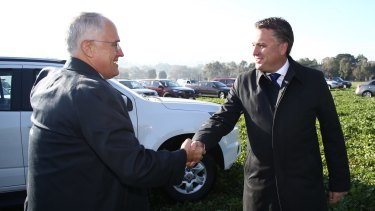 Prime Minister Malcolm Turnbull with the former member for Mayo, Jamie Briggs.