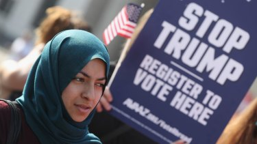 A young Muslim woman at an anti-Trump even in Berlin, Germany, prior to the US elections.