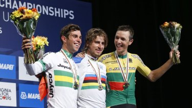 Podium pals: Peter Sagan, centre, of Slovakia, winner of the road world championship, celebrates with runner-up Michael Matthews, left, and third-placed Ramunas Navardauskas, of Lithuania, in Richmond, Virginia.