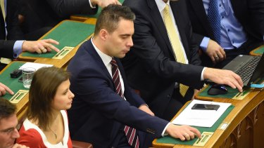 Chairman of the far-right opposition Jobbik party Gabor Vona, centre, prior to the vote.