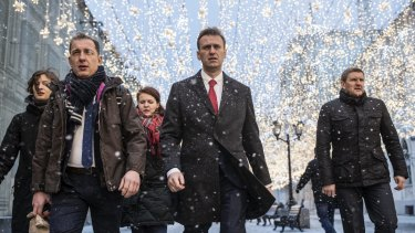 Russian opposition leader Alexei Navalny, centre, heads to attend a meeting at the Central Election commission on Monday.