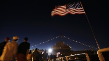 Supporters on their way to hear Donald Trump speak during a rally coinciding with Pearl Harbor Day aboard the aircraft carrier USS Yorktown in South Carolina.