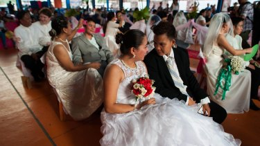 "Filipino gay couples exchange ""Rite of Holy Union"" vows during a mass ""wedding rites"" in June in Manila. A small Christian ecumenical group officiated the weddings, but the unions are not officially recognised under law."