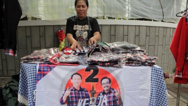 An Ahok shirt seller waits for customers in the Jakarta suburb of Menteng.