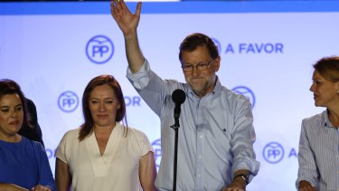 Mariano Rajoy waves to his supporters after the result, which improved the position of his People's Party after an inconclusive election last year.