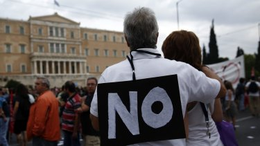A protester wears a 'No' sign during an anti-European Union demonstration outside the Greek parliament at Syntagma square in Athens on June 28.