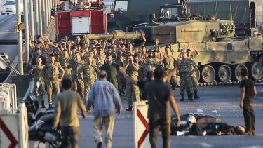 Soldiers involved in the coup attempt surrender on Istanbul's Bosphorus bridge on Saturday.