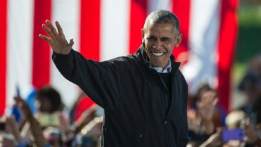 Welcome: President Obama walks to the podium at a campaign rally for Clinton on Friday.