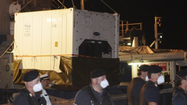 A refrigerated container with the bodies of dead migrant is unloaded from Swedish ship Poseidon at the Palermo harbour on Thursday.