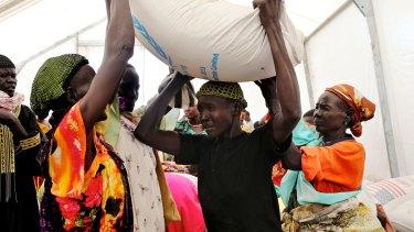Familiar sight: Queues form at the United Nations food distribution centre at Mingkaman, South Sudan.