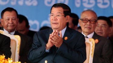Cambodian Prime Minister Hun Sen, centre, applauds during the 66th anniversary of the Cambodian People's Party in June.