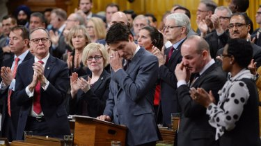 "Prime Minister Justin Trudeau wipes his eye while making a formal apology to individuals harmed by the decades-long ""gay purge"" in Canada."