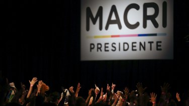 Supporters of opposition presidential candidate Mauricio Macri celebrate at his campaign headquarters the first results of the election in Buenos Aires, Argentina on Sunday.