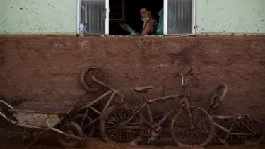 A man works on the cleaning of a house flooded with mud in Barra Longa, Minas Gerais, two days after the accident.