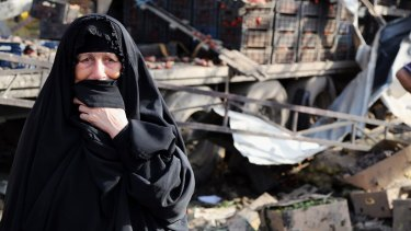 An Iraqi woman grieves at the scene of a bomb attack in Jameela market in Baghdad's crowded Sadr City neighbourhood.