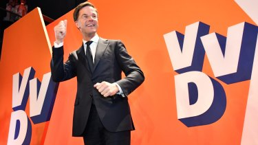 Dutch Prime Minister Mark Rutte of the free-market VVD party celebrates after exit poll results of the parliamentary elections were announced in The Hague.