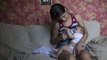Angelica Pereira feeds her daughter Luiza, who was born with microcephaly in Santa Cruz do Capibaribe, Brazil.