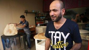 Abdul Halim al-Attar outside his bakery in Beirut.