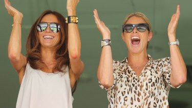WAGs: Kyly Clarke and Candice Falzon, pictured in Brisbane in 2013.