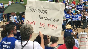 Protesters at the state Capitol building  in Little Rock on Friday.