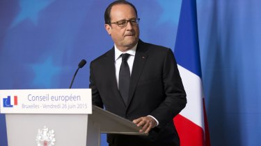 """""""The attack is terrorist in nature"""": French President Francois Hollande gives a statement at the European Council headquarters."""