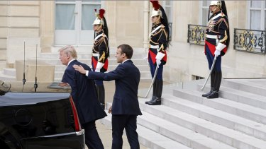 Emmanuel Macron escorts Donald Trump after their meeting at the Elysee Presidential Palace in Paris.