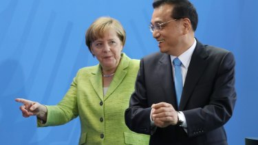 German Chancellor Angela Merkel and Chinese Prime Minister Li Keqiang in Berlin on Friday.
