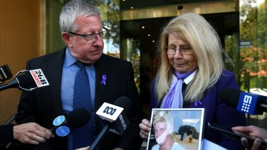Mark and Faye Leveson with a photograph of their son Matthew Leveson.