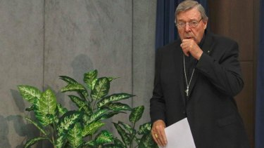 Accused: Cardinal George Pell arrives to meet the media at the Vatican on Thursday.