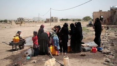 People fill buckets with water from a well that is alleged to be contaminated water with the bacterium Vibrio cholera, on the outskirts of Sanaa, Yemen.