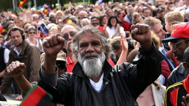 Reg Edwards raises his fists in triumph outside Parliament House after watching a live broadcast of Kevin Rudd's apology to the stolen generation.