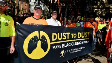Workers and union members protest for workers rights and the treatment of victims of black lung disease in April.