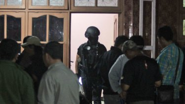 Indonesian police officers from the Special Detachment 88 anti-terror unit raid a hideout used by suspected militants.