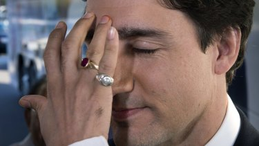 "Canadian Liberal Leader Justin Trudeau receives a traditional Hindu ""bindi"" decoration on his forehead as a welcoming gesture at the Sanatan Mandir Cultural Centre in Markham, Ontario, on Friday.  Canadians will go to the polls in the federal election on Monday."