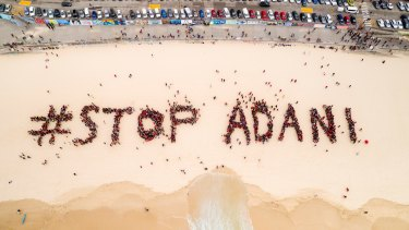Organisers estimated 1500 people gathered on Bondi Beach on Saturday to protest the Adani mine.