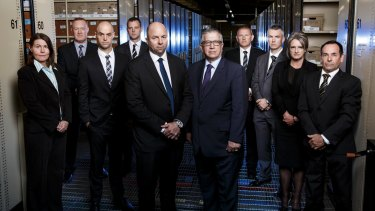 Detective Senior Sergeant Peter Trichias, fifth from left, with his Homicide Squad Cold Case Team.
