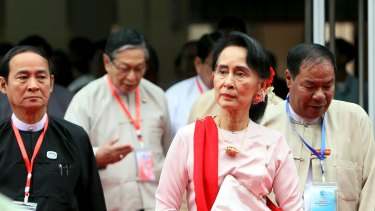 Myanmar's State Counsellor Aung San Suu Kyi, second from right, arrives to attend the Forum on Myanmar Democratic Transition last month in Naypyitaw.