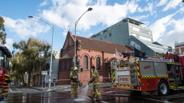 Firefighters clean up Victoria Parade.
