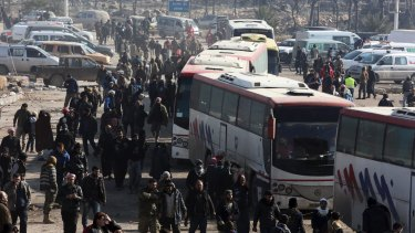 Syrians evacuated from Aleppo arrive in buses at a refugee camp in Rashidin, Syria.