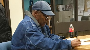 Released: OJ Simpson signs his release documents at the Lovelock Correctional Center in northern Nevada.