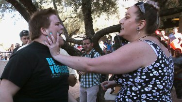 A Donald Trump protester and supporter in an altercation at the conclusion of a Trump rally at the Tucson Convention Centre on Saturday.