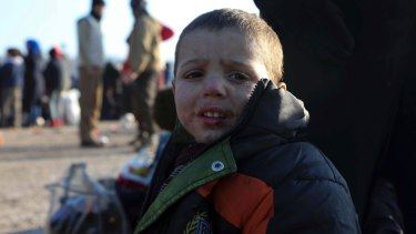 A young Syrian boy evacuated from Aleppo arrives at a refugee camp.