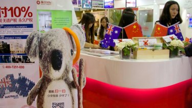Booths promoting Australian property at an international property fair in Beijing.