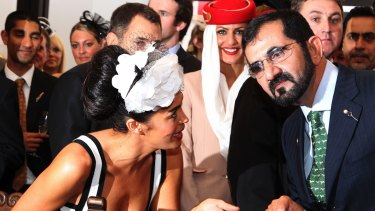 Megan Gale with Sheikh Mohammed bin Rashid al Maktoum, who had another disappointing Cup campaign.