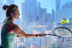 Belarusia's Aryna Sabalenka practises volleying with a view at the Grand Hyatt in Melbourne.