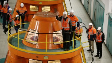 Prime Minister Malcolm Turnbull views a generator during his tour of the Snowy Hydro Tumut 2 power station on Monday.