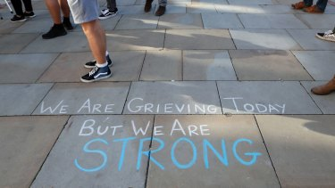 A message is written on the pavement in Manchester.