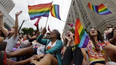 Hundreds of thousands of people packed gay pride events from New York City to Seattle, San Francisco to Chicago last month to celebrate the Supreme Court ruling legalising same-sex marriage.